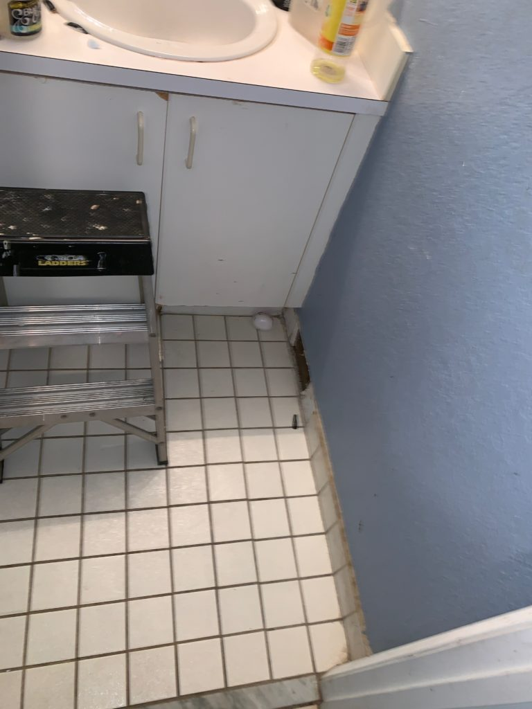 water damage behind cabinets and sinks