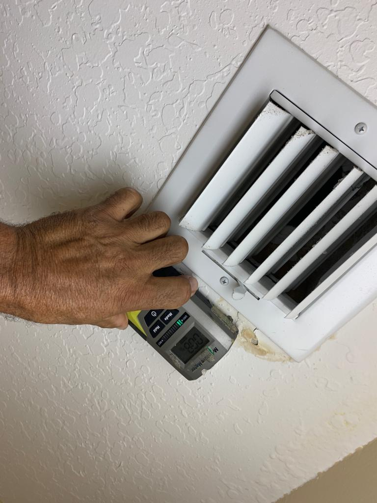 mold meter to indicate water behind walls